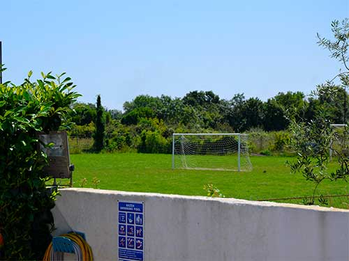 view of the football pitch from the Hostel garden
